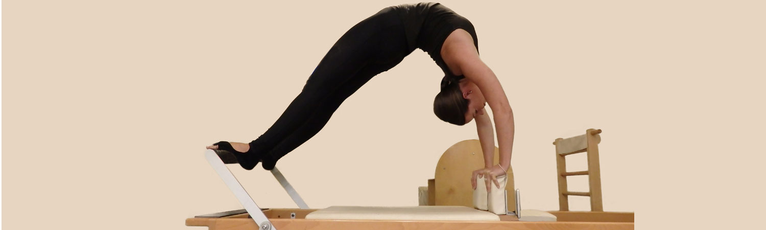 Roisin-back-bend-on-reformer